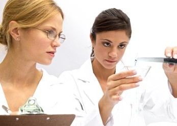 Two Females Testing Substance - Rapid-Screening Assays
